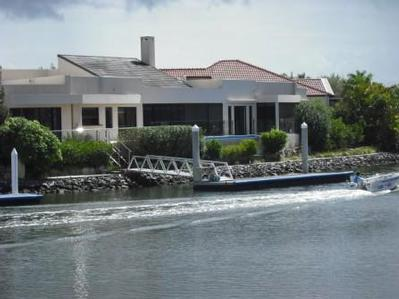 LUXURY HOME BUILT FOR A BOATY WITH A BiiiG BOAT Picture